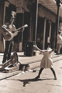 girl dancing to man with guitar
